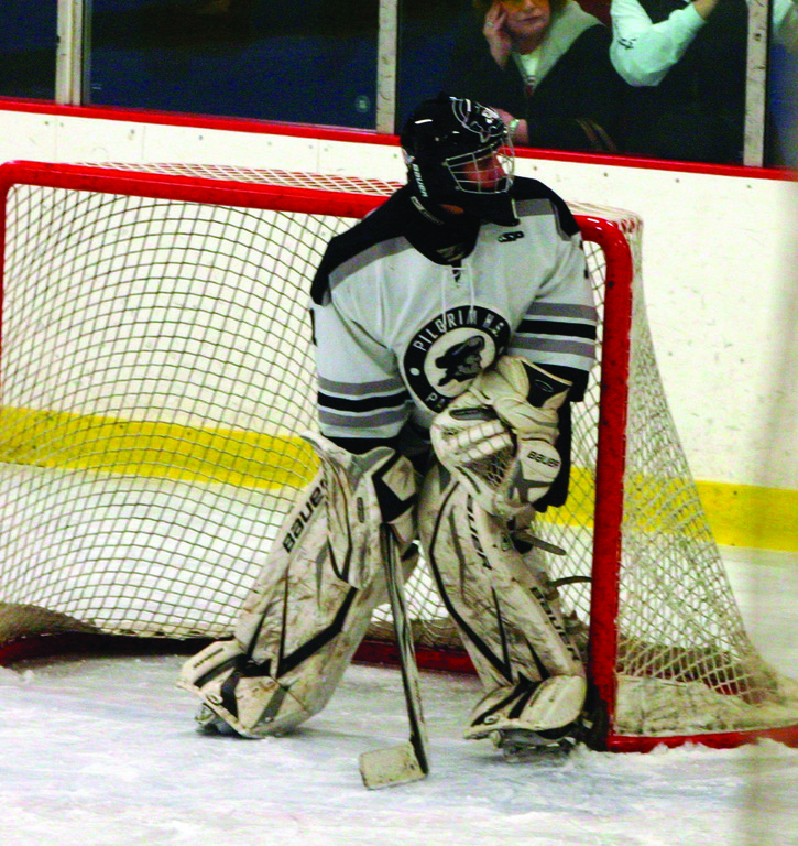 EYE ON THE PRIZE: Pilgrim goalie Ian Giuttari peaks over his shoulder as play goes on behind the net during Saturday's game two of the Division II semifinals.