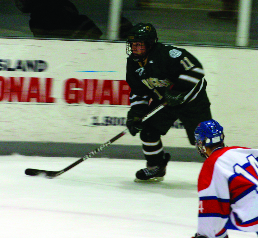HEAD UP: Paul Filippone looks to center the puck on Saturday.