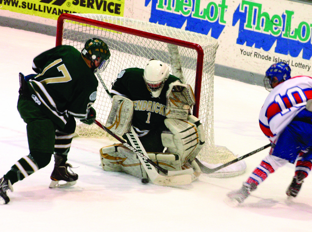 DOWN IN FRONT: Hendricken's Billy Palmer stops a puck in front of teammate John Cute and Mount's Tyler Scroggins in game two of the state championship series.