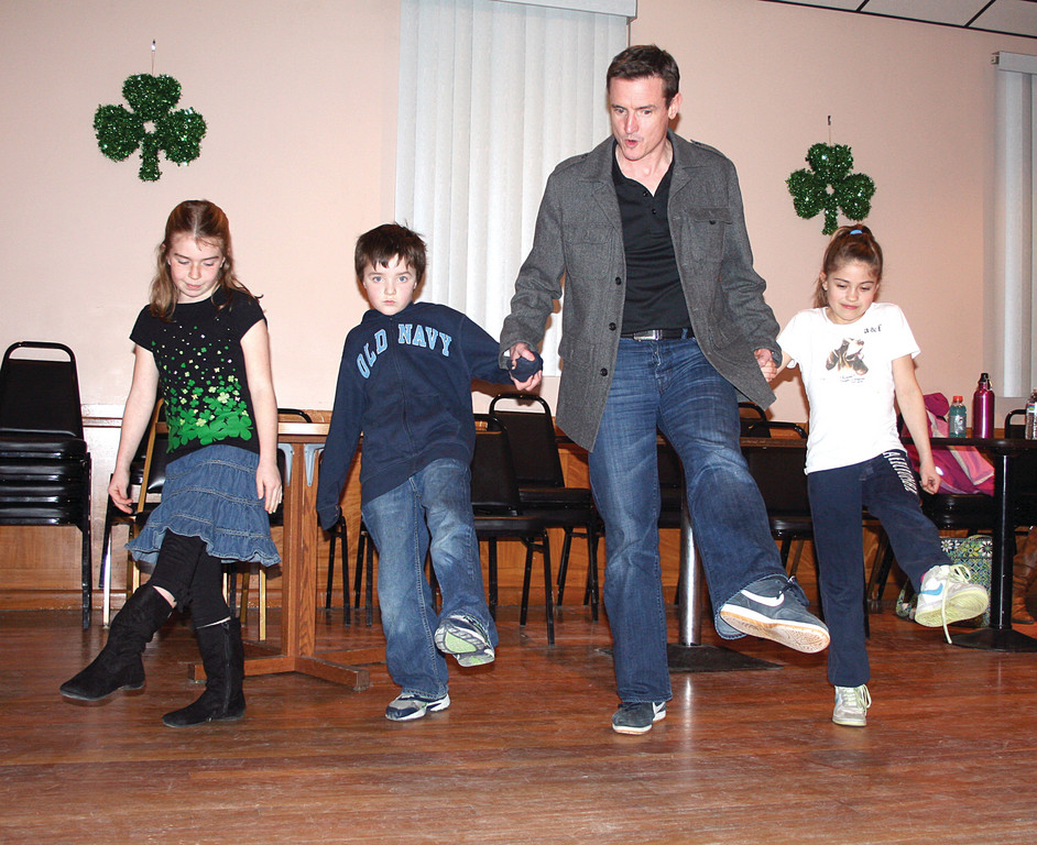 Liam Harney walks newcomers Erin O'Toole, Caleb Maytum and Samantha Haggerty through a few steps.