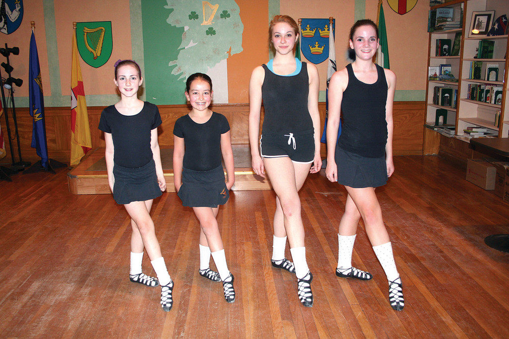 Dancers from the Harney Academy of Irish Dance line up before practice at the Ceilidhe Club of Rhode Island. Pictured from left are 11-year-old Shannon Fogarty, 11-year-old Caroline Harten, 15-year-old Elizabeth Gallagher and 14-year-old Katherine Birch.