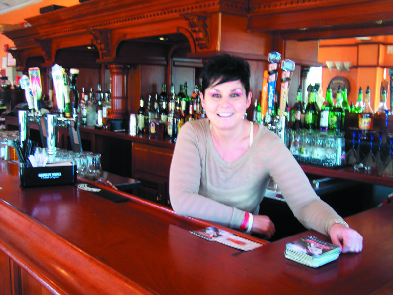 Cora McAuliffe prepares for another busy night of hungry diners and revelers at her County Cork Irish Pub in Warwick.