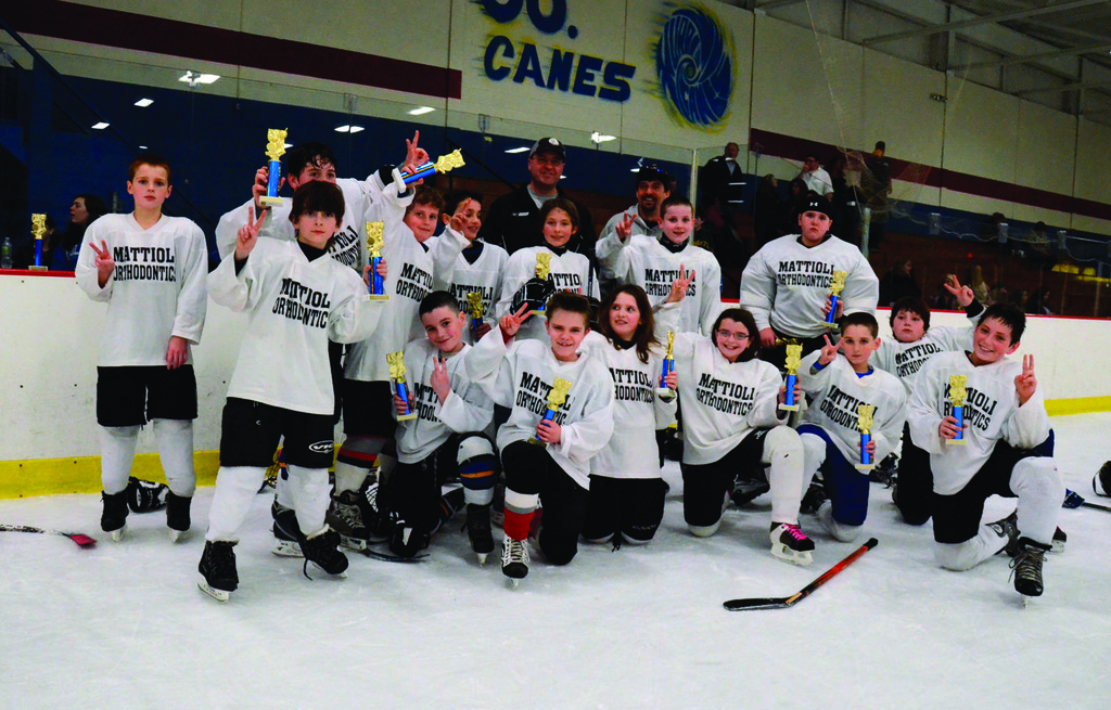 Mattioli Orthodontics, the runners-up in the Squirt division, are comprised of Madson Dowling, Mason Savaria, Max Savaria, Spencer Hallagan, Kelly McCarthy, Adam Lamont, Nick Franklin, Cara Burgess, Matthew Carr, Sam Slaiby, Ben Spyes, Zachary Sayles, Max Caracuzzo, Grayson Ahearn and Alexia Bessette.