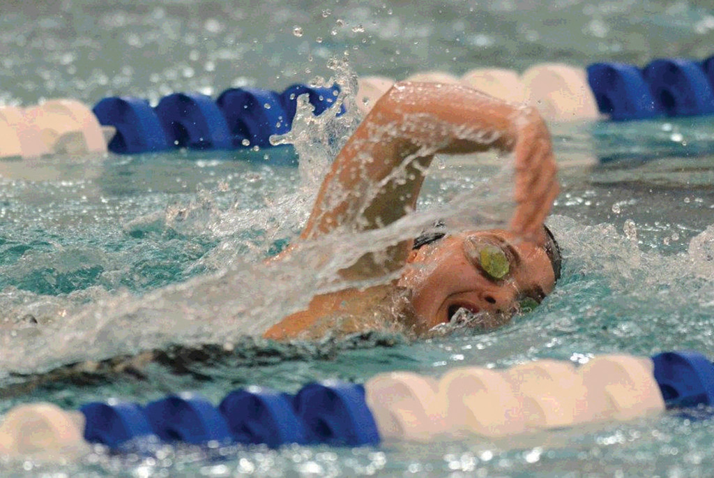 SPRINT TO THE FINISH: Carolyn Cote of Warwick competes in the 500 freestyle at the South Eastern New England YMCA Championships earlier this month.