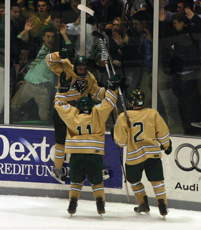GOOD TIMES: Dave Mitchell celebrates his first-period goal with Paul Filippone and Andrew Fera.