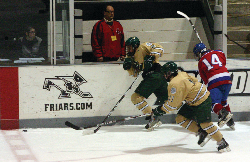 Austin Navarro and Paul Filippone chase after a loose puck.