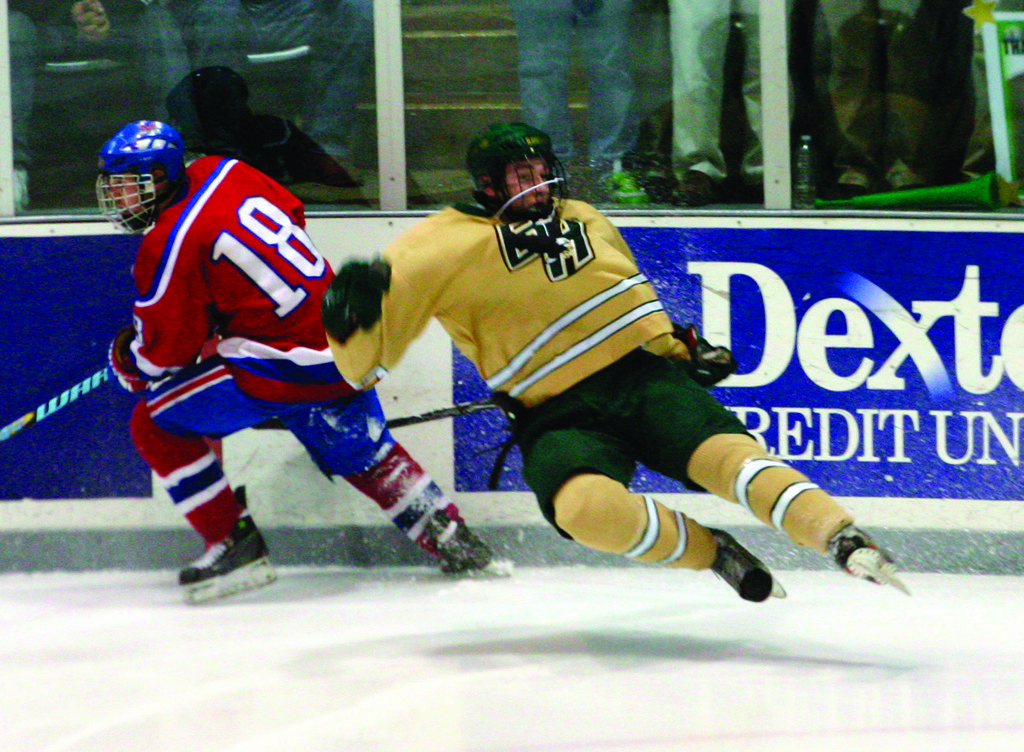 ON THE MOVE: Justin Finan gets tripped up by Mount's Ben Handanyan in Monday's game.