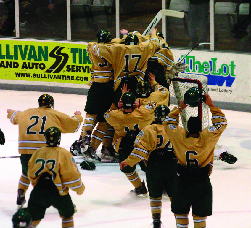 MOBBED: Hendricken players rush onto the ice to celebrate Monday's championship-clinching win.