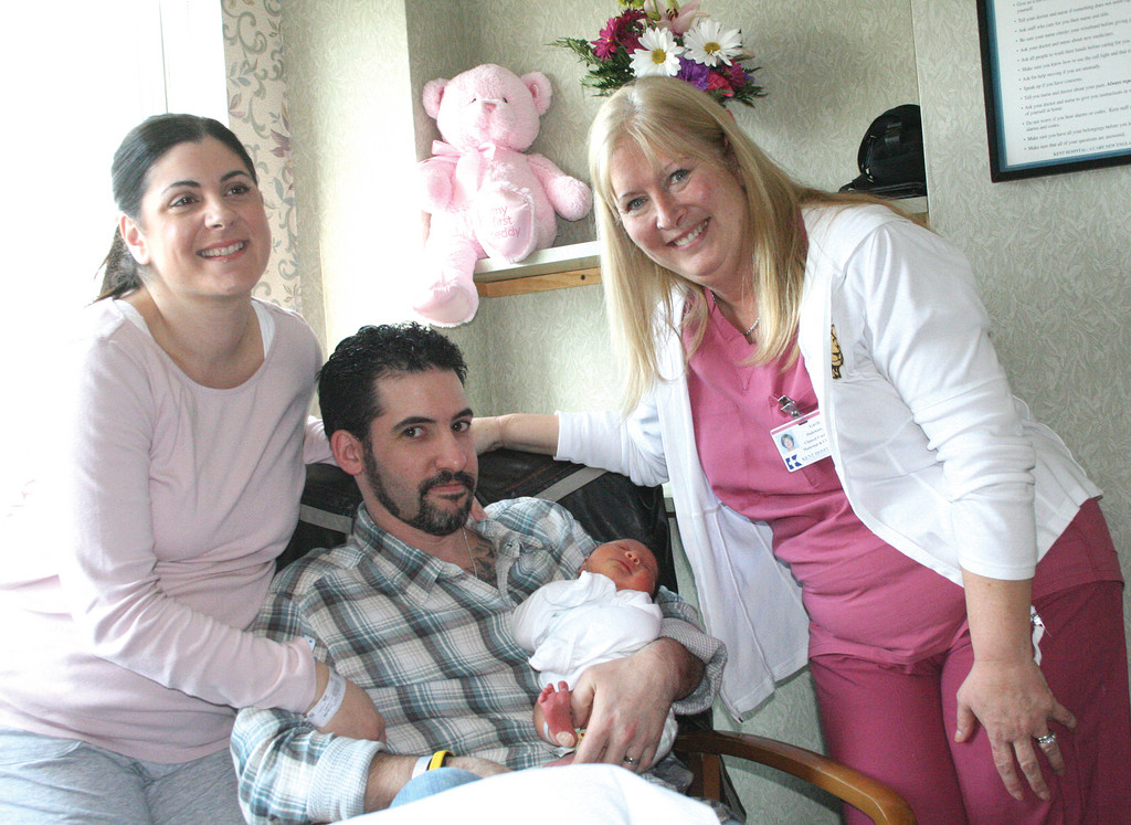 "IT'S A GIRL! For the second year in a row, Kent Hospital was named the recipient of HealthGrade's maternity care excellence award. ""The staff here is phenomenal,"" said Charity Ancone, who gave birth to her second child, a baby girl named Ava, on Saturday. Charity is with her husband, Matt, and Kent's clinical coordinator of labor and delivery, Gayle Dadekian."