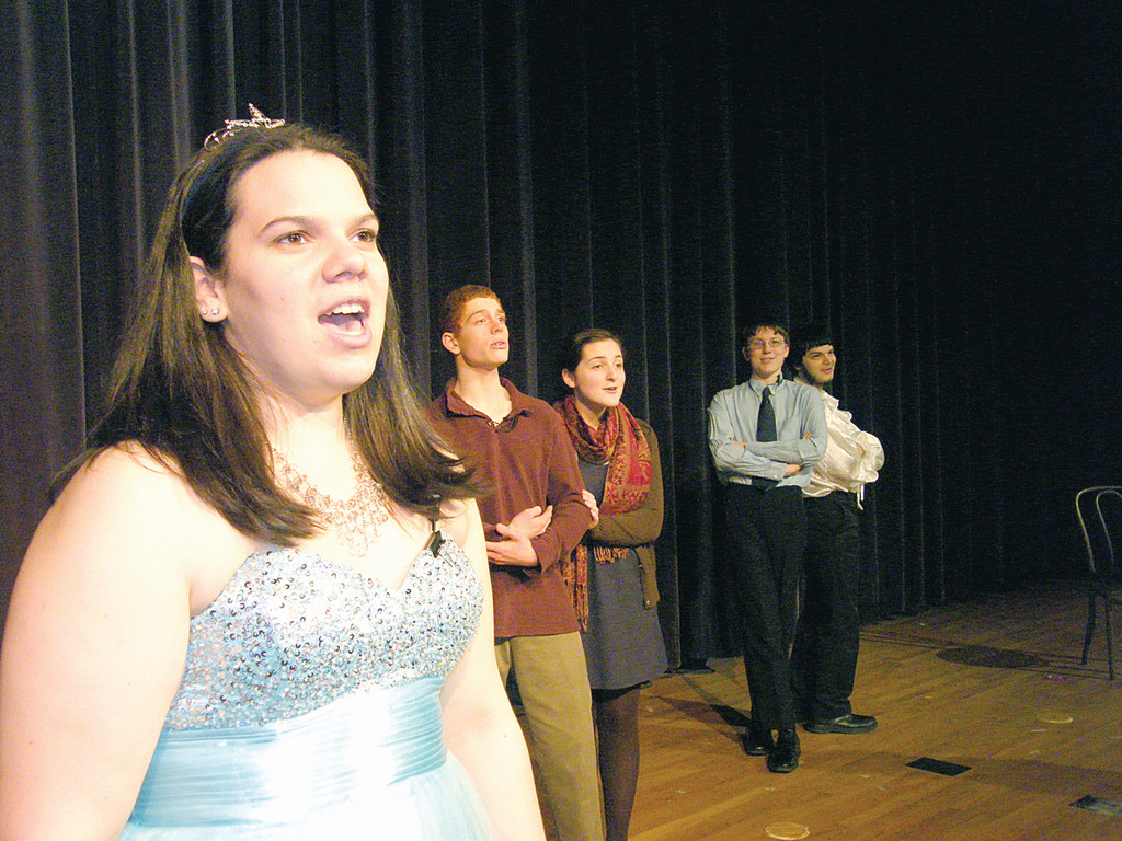 READY FOR THE BALL: In the foreground, Andrea Drowne belts out a tune as Cinderella. Behind her are, from left, Dante Procopio as The Baker, Julia Paolino as The Baker's Wife, Ben Hodge as Cinderella's Prince/The Mysterious Man and Jacob Rosenberg as Rapunzel's Prince/The Wolf.