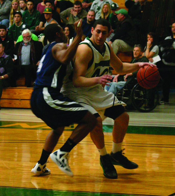 Isaac Medeiros heads for the basket. Livramento and Medeiros are key parts of CCRI's frontcourt.