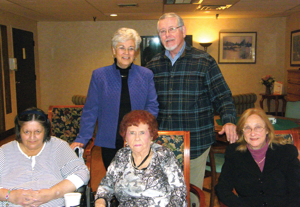 SADDENED BY THE NEWS: Some residents and their families don't want to see Pawtuxet Village Care and Rehabilitation Center closed by the Department of Health. Pictured are, front row from left: residents Shirley Dorman and Helen Carroll and family member Mary Apici; (back row) Maria and Ed Rondeau, family members of a resident.