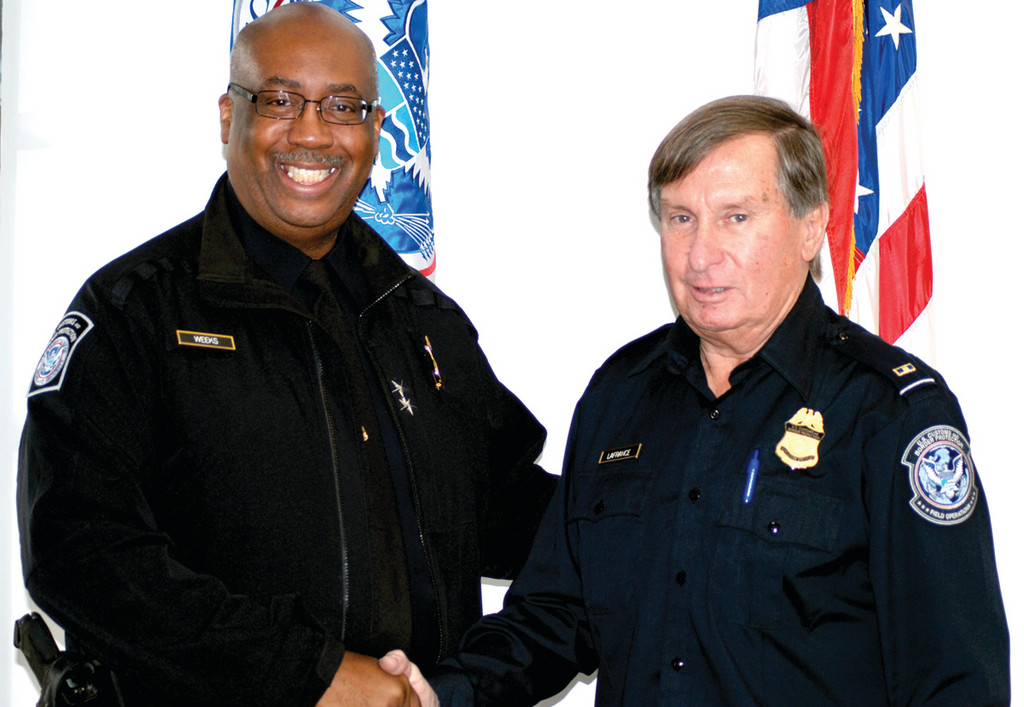 Director of Field Operations Kevin Weeks says goodbye to Warwick's Robert LaFrance as he retired as an inspector and scientist for Customs and Border Protection in the Department of Homeland Security.