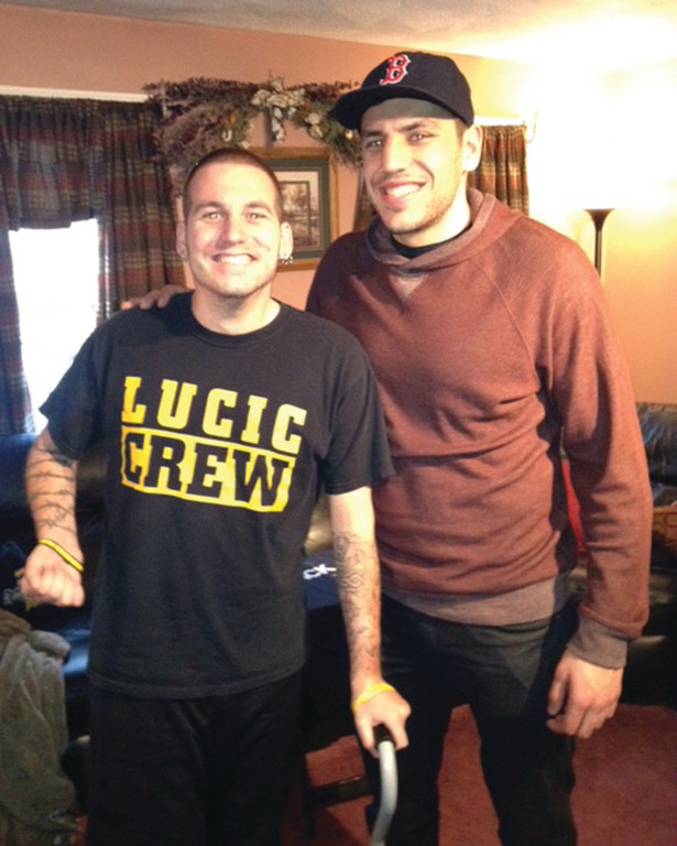 SPECIAL DAY: Warwick's Mike Barber, left, got to spend some time with the Boston Bruins' Milan Lucic two weeks ago.