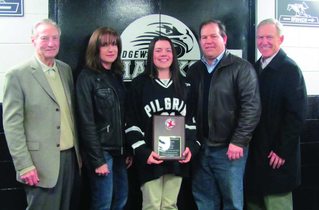 SALUTE: Among those people who helped honor Pilgrim High hockey standout Susie Cavanagh (center) last Friday evening at Providence College's Schneider Arena were, from lefth Hall of Famer Ferny Flaman, Susan's mother Melinda and father Richard Cavanagh and uncle and and one-time Harvard All-American Joe Cavanagh.