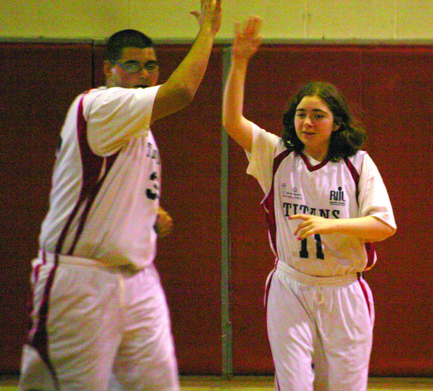 Christopher Delvecchio and Destiny Murray share a high five.