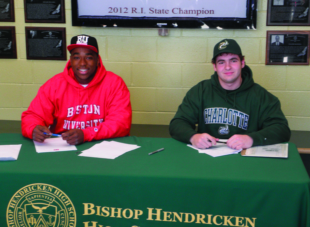 SIGNING ON: Hendricken's Reuben Horace (left) and John Celona made their college commitments official earlier this month.