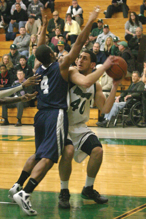 ON THE WAY UP: Isaac Medeiros looks for his shot  in the paint during a game earlier this season.