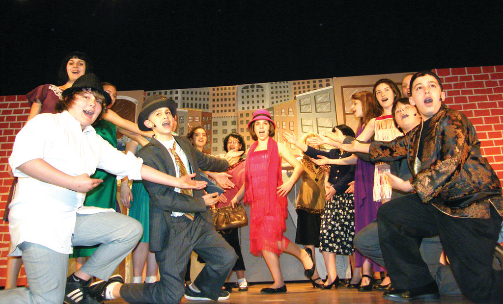 STRIKE A POSE: The cast surrounds eighth grader Nicole Morales who plays Millie Dillmount.