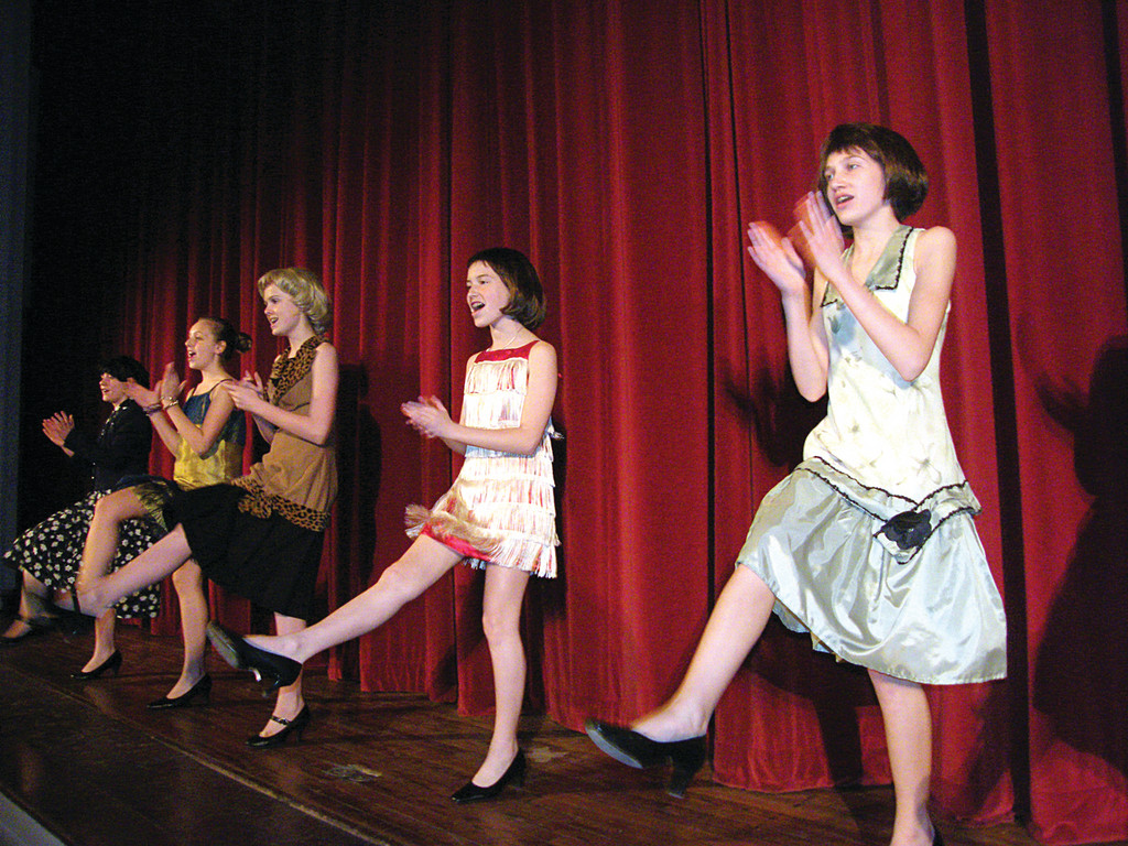 DO THE CHARLESTON: Cast members (from left) Faith Maloney, Abby Comtois, Amanda Corley, Mary Mullane and Bryana Mullins kick up their heels.
