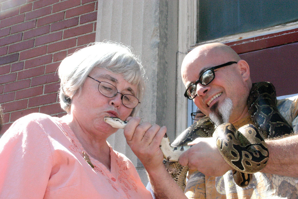 SERPENT SMOOCHIES! Librarian Marsha Richardson gives Jeffrey a quick peck.