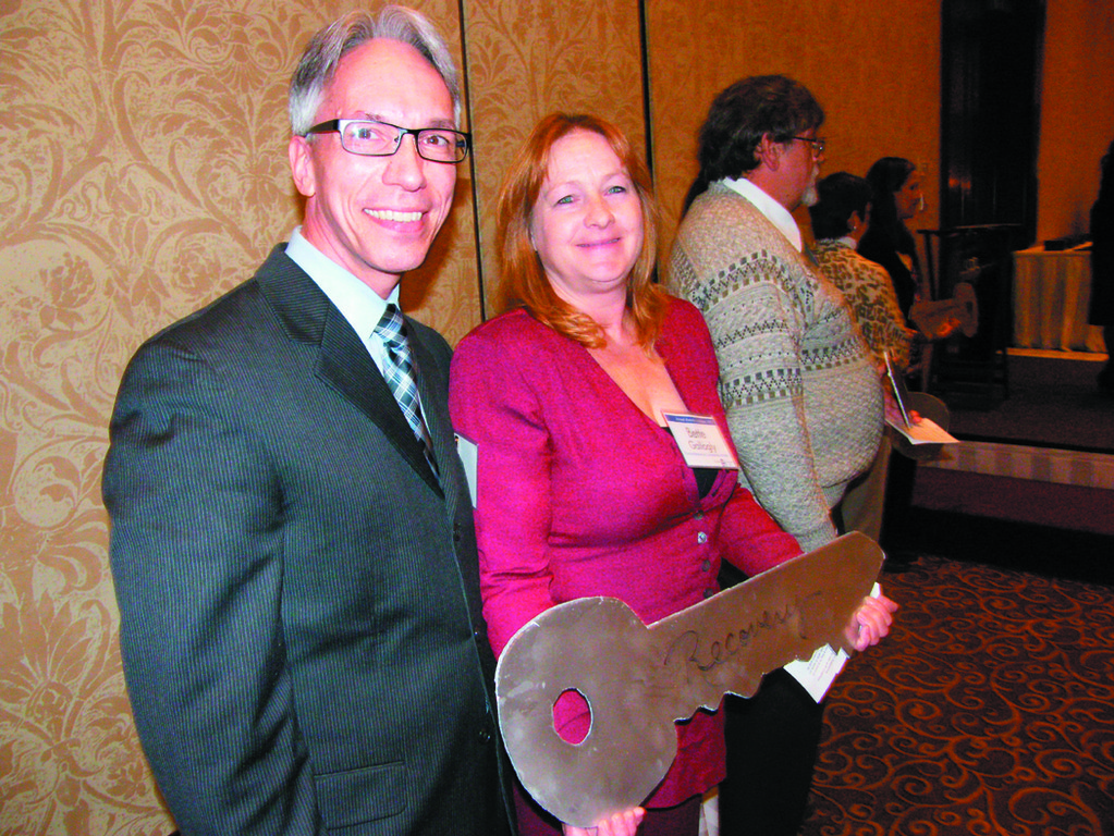 KEY TO ENDING HOMELESSNESS: Jim Ryczek, Executive Director of the Rhode Island Coalition for the Homeless Executive Director stands with board member Betty Gallogly, who spoke as part of the keynote presentation.
