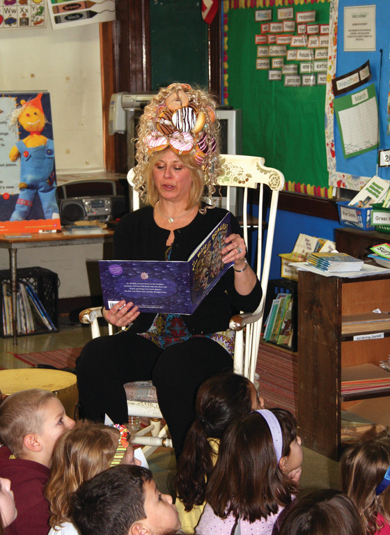 HER HAIR IS MADE OF DONUTS: When Joy Feldman visits schools to read, she wears a specially created donut wig to illustrate her point: you really are what you eat.