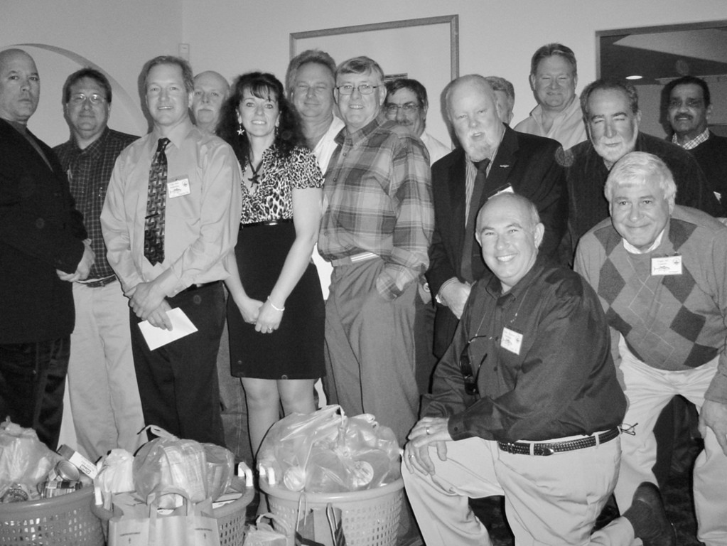 Members of the Rhode Island Party & Charter Boat Association donate canned goods to the Johnny Cake Food Pantry in South County.  The food was donated by guests and Captains of the association at their annual banquet which was held at Spain Restaurant in Narragansett.