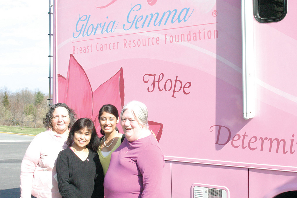 AND THEN THERE WAS HOPE: The Hope Bus is a 38-foot pink recreational vehicle operated by the Gloria Gemma Breast Cancer Resource Foundation, which aims to raise awareness about breast cancer and assist women in need through funds and healing activities. Yesterday, Hope was at the Community College of Rhode Island�s seventh annual Wellness Fair. From left, Maureen DiPiero; Tel Gingras; Komal Talato; and two-time cancer survivor Mary Jane Bohlen.