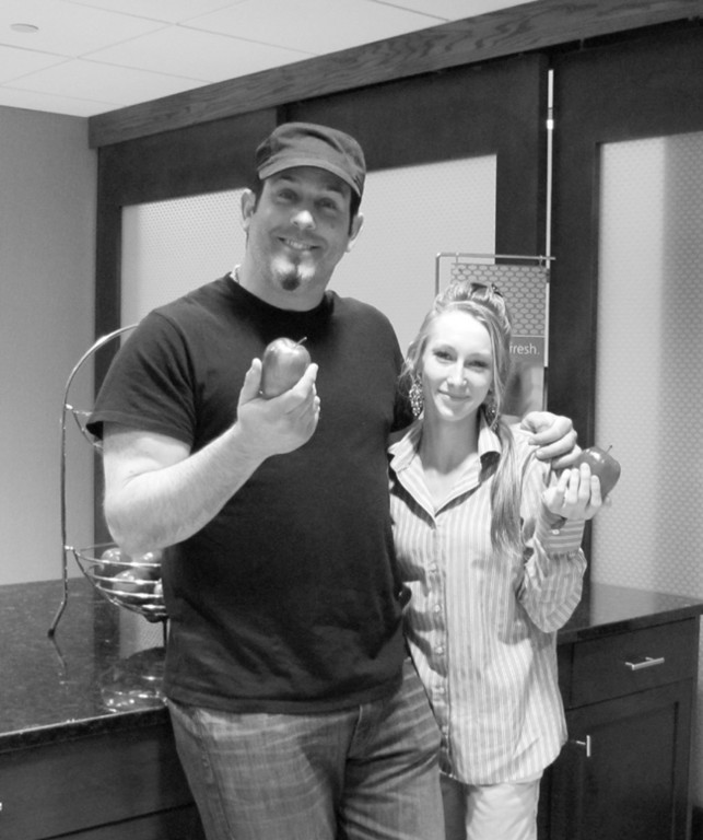 ALWAYS THE HAM: Craig Gass, a highly-accomplished comedian who does impersonations of national celebrities such as Al Pacino, hams it up with Hampton Inn & Suites kitchen staffer Danika Crothes during his stay in Warwick last weekend.