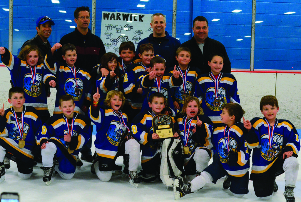 CHAMPS: WJHA's Mite B team shows off its trophy after winning the Mite B Gold state championship on Monday night in Smithfield.