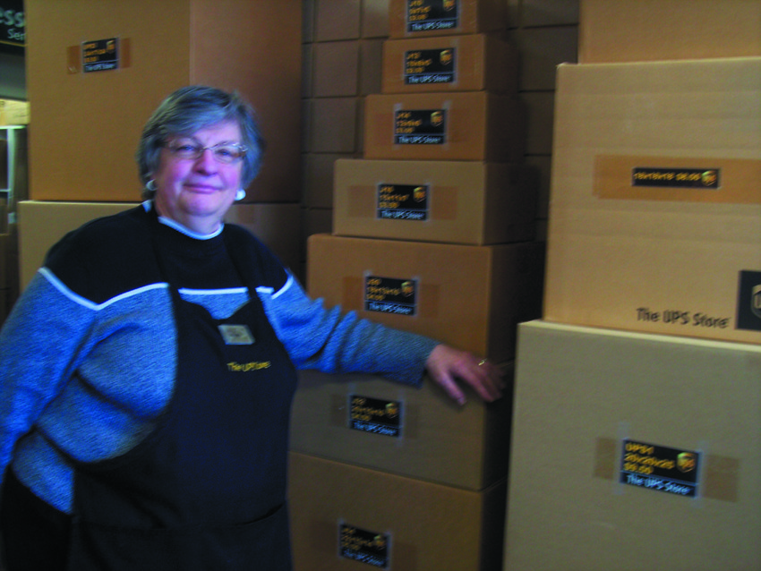 Owner Eileen takes a short break to showcase some of the boxes now available for volume buying at the UPS Store.