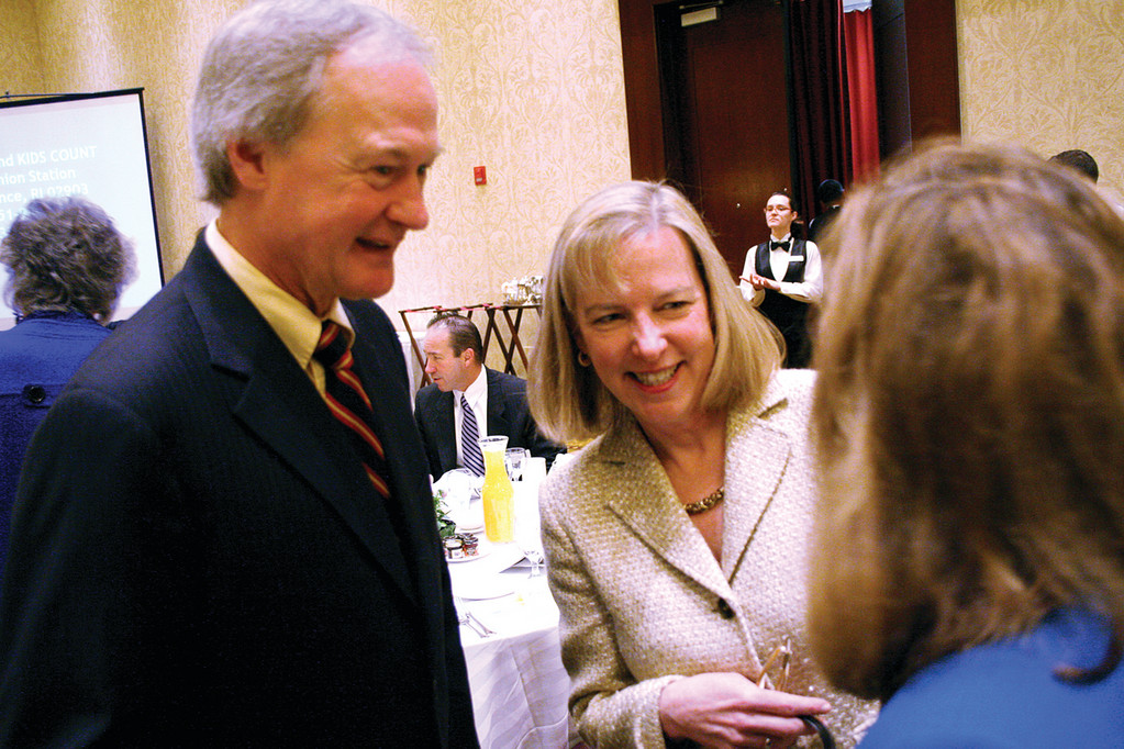 AT KIDS COUNT BREAKFAST: Governor Lincoln Chafee and Elizabeth Burke Bryant, executive director of Rhode Island Kids Count, talk with Joan Lombardi, keynote speaker at yesterday's announcement breakfast.