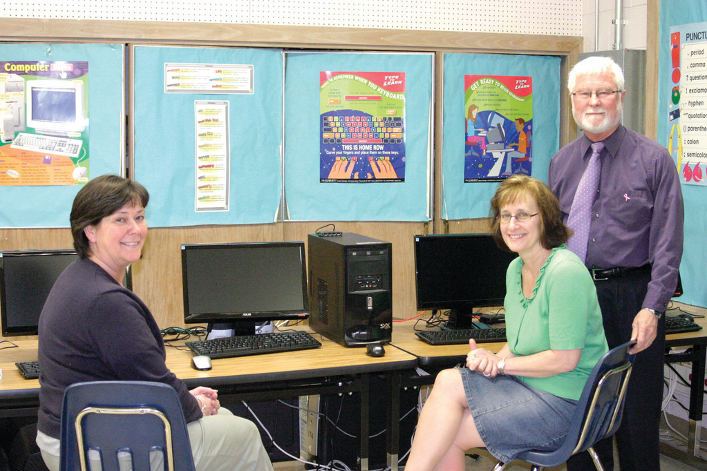 NEW TEACHING APPROACH: Through the Early Learning Academy, a program that integrates and socializes younger students with children a grade or two ahead of them so they can learn at higher levels if they are excelling in certain subjects, St. Kevin's School is taking a new approach to teaching their youngest students. Pictured here in the computer lab are teachers Mary Ann McKenney, Maria Modelane and Principal Roger Parent.