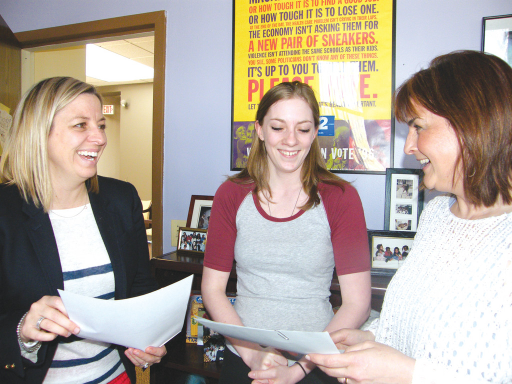 SAYING YESS: At left, Lisa Guillette, executive director of the Rhode Island Foster Parents Association, talks with YESS participant Sarah Smith (center) and Kim Rose, director of Rhode Island Council of Resource Providers for Children, Youth and Families. Smith aged out of the foster care system in December and now relies on the YESS program to supplement her rental payments.