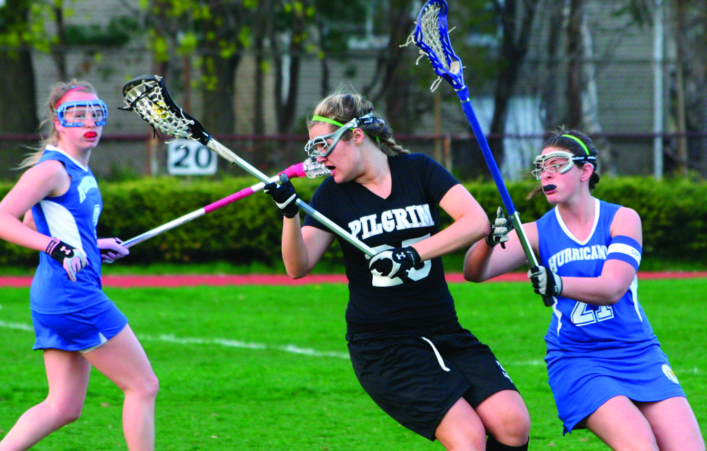 STICK WORK: Pilgrim's Brianna Boucher controls the ball during a game last season against Vets.