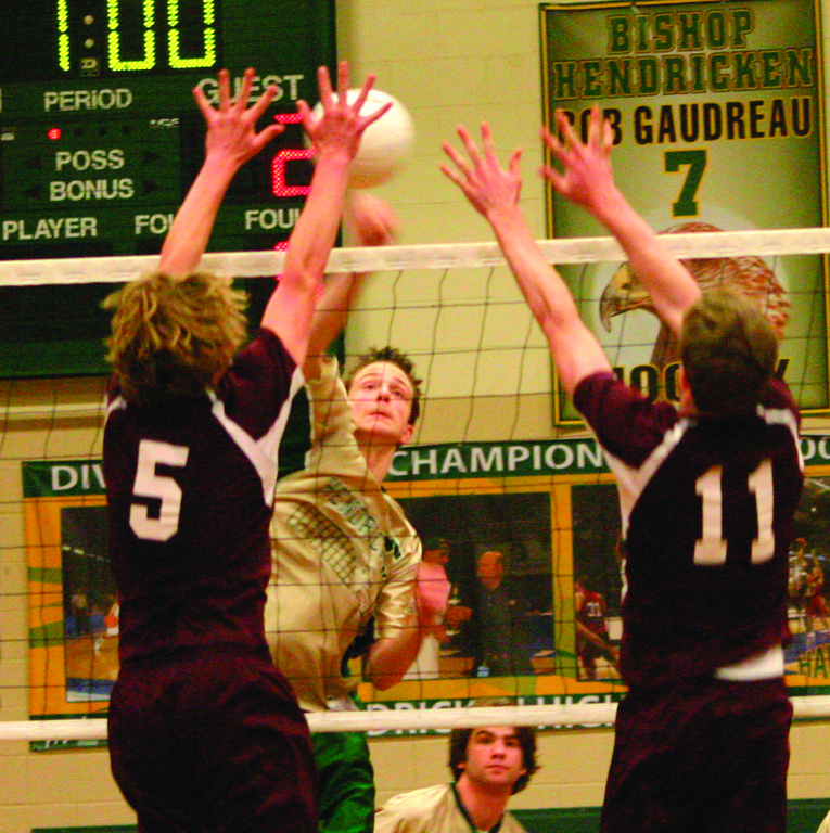 IN BETWEEN: Hendricken's Brendan Baker tries to place a kill between two La Salle blockers in a match last year. The Hawks lost the core of last year's undefeated team, but Baker and John Kane are back to lead a new group this year.
