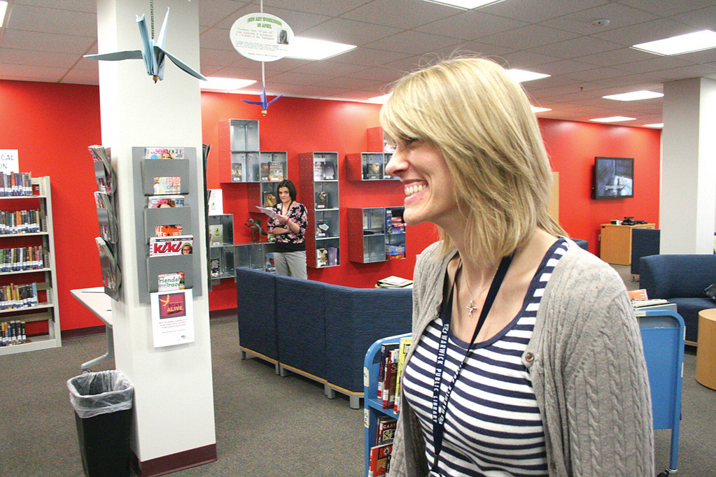 KEEPING TRACK: Ellen O'Brien, coordinator of children's and teen services at the library, calls the new teen space a success.