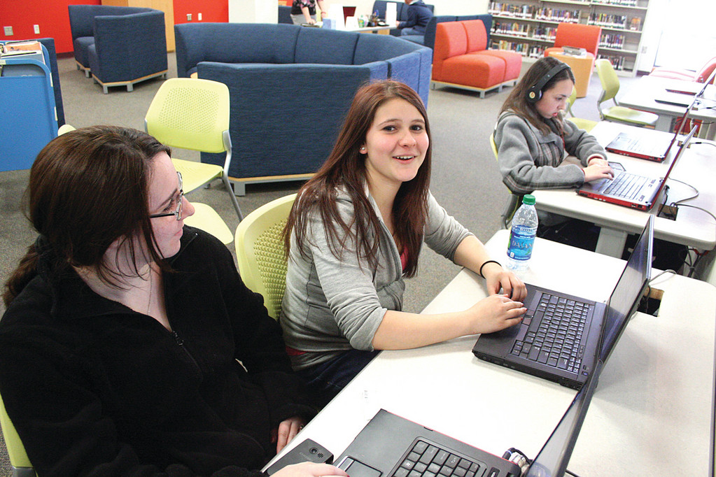 IT'S FACEBOOK: Using computers in the teen space at the Warwick Public Library Ashley Gardner and Laura Paulin, both Vets students, stay in touch with their friends.