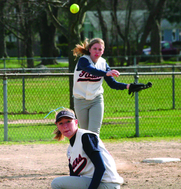 DUCK AND COVER: Toll Gate pitcher Katie McCaughey gets out of the way as third baseman Courtney Conklin fires a throw to first in Monday's season opener against Cranston West.