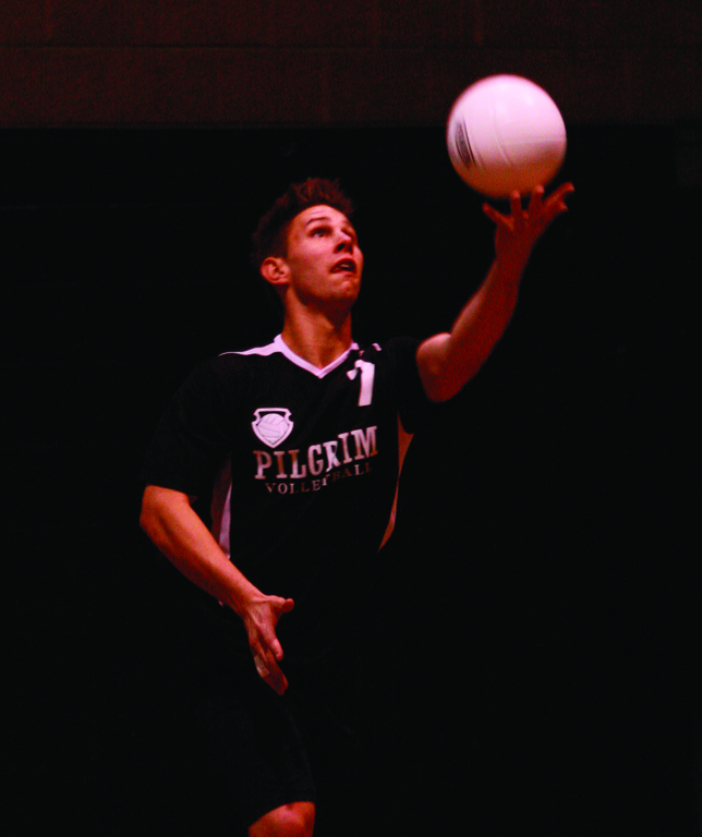 Sean St. Jacques sets up his serve.
