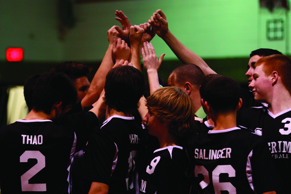 Pilgrim players break the huddle.