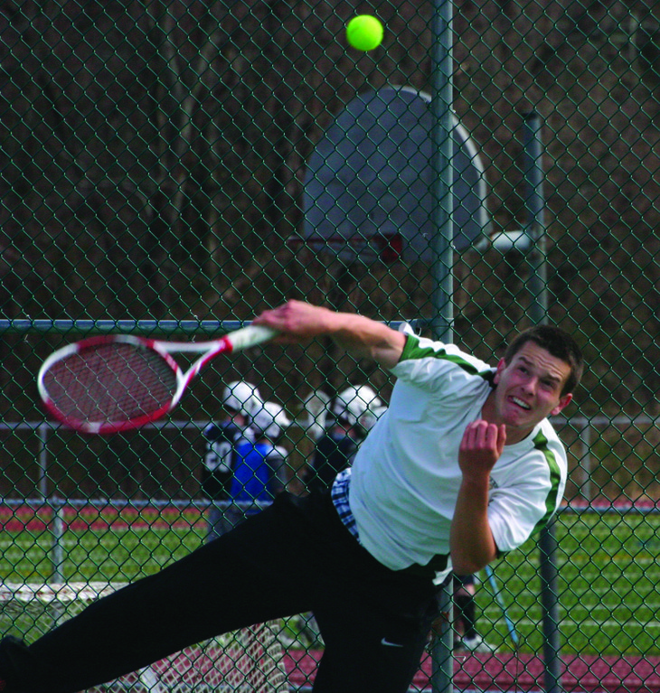 FOLLOW THROUGH: Hendrickenk's Evan Chomka unleashes a serve at No. 2 singles on Thursday. Chomka is one of three seniors anchoring the lineup for the Hawks this season.