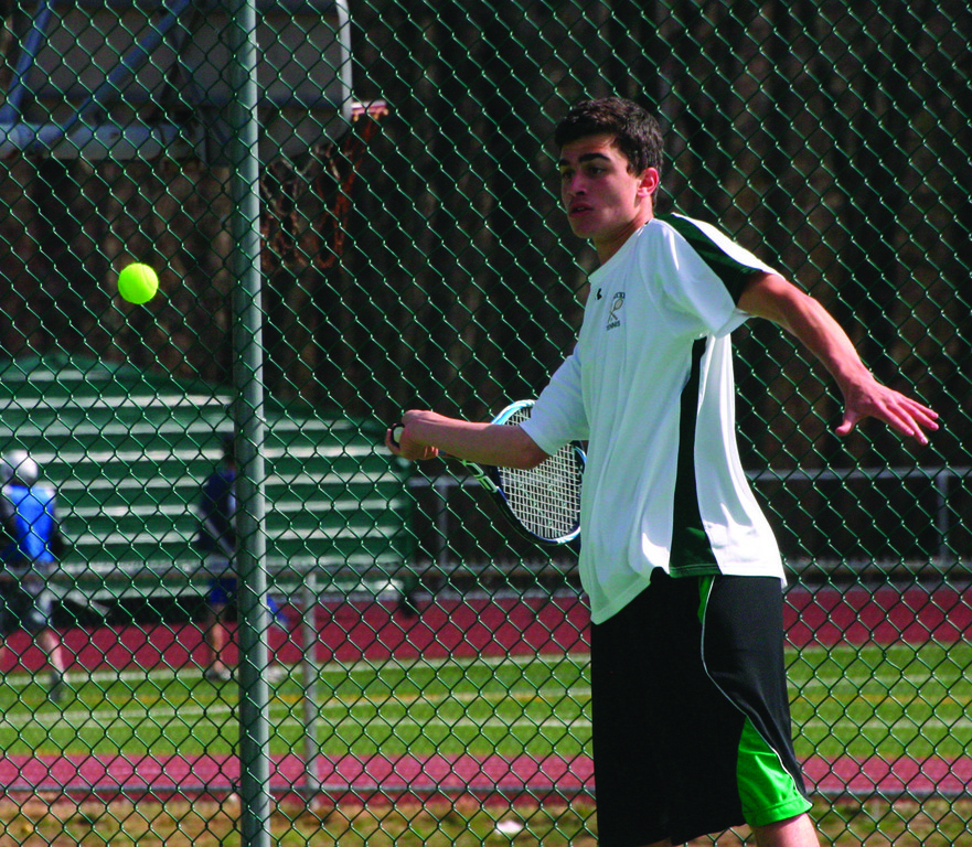 No. 3 singles player Zach Prinscott winds up on a forehand.