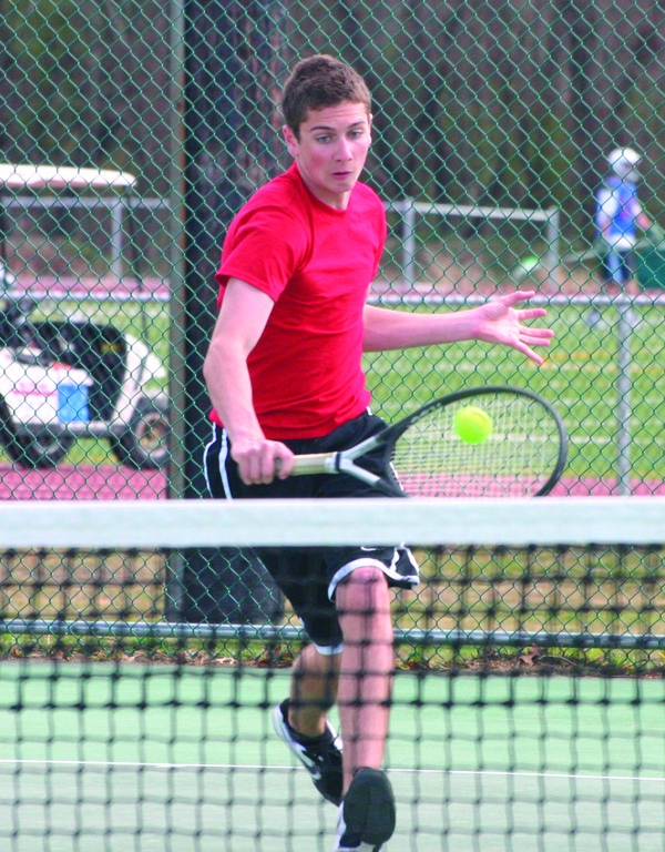CHARGING: Justin Allen comes to the net for a backhand in Thursday's match against Hendricken.