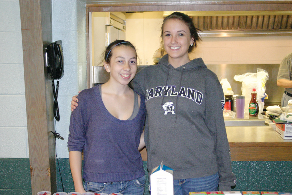HOPPING TIME: Toll Gate juniors Rachel Walker, 16, (left) and Casey Johnson, 17, volunteered at a breakfast that was held after the service at Warwick Central Baptist Church.