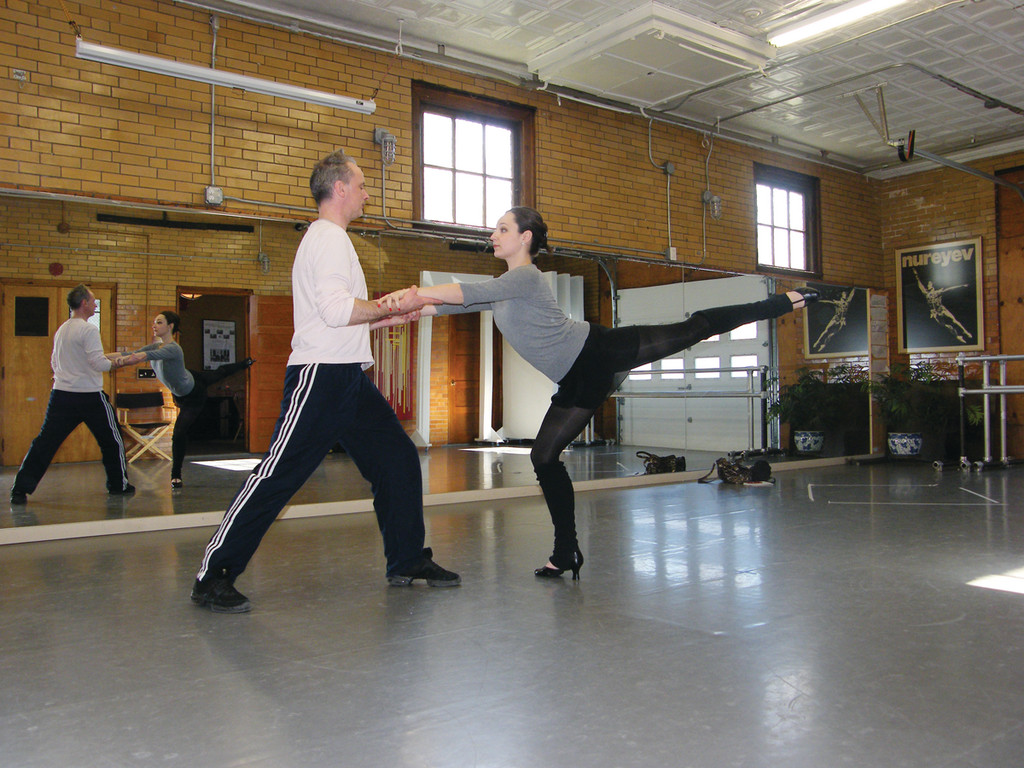 "ARABESQUE: Michael Bolger plays the Father, and Elizabeth Rogers plays the Stepmother in Providence Ballet Theatre's premier of ""Hansel and Gretel"" by Roger Seitz. Here, the pair rehearses a pas de deux, or dance for two."