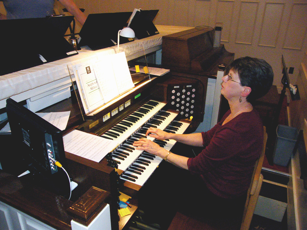 TICKLING THE IVORIES: Greenwood Community Church, Presbyterian music director Kathy Hart plays the church's new Rodgers organ at a bell choir rehearsal last week. The $68,000 instrument will have an inaugural concert April 15.