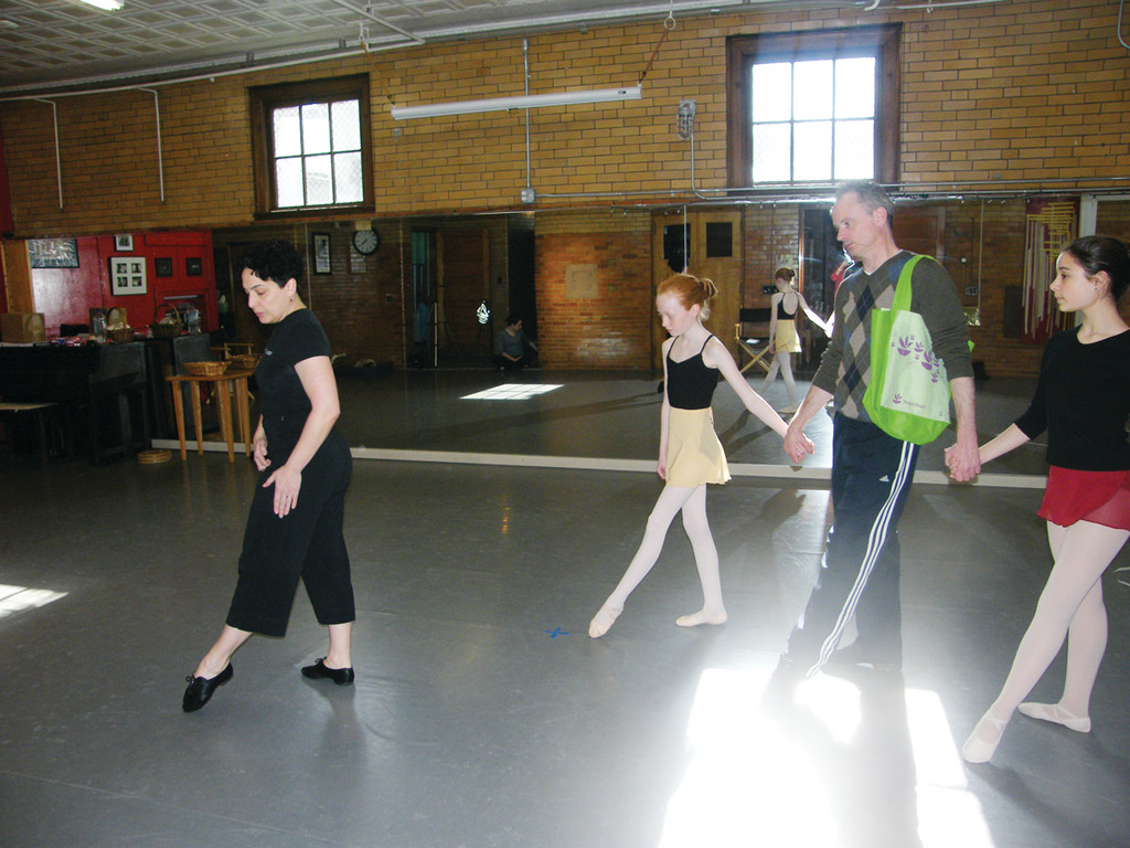 "PRACTICE MAKES PERFECT: At far left, Eva Marie Pacheco, founder and director of Providence Ballet Theater, teaches choreography for ""Hansel and Gretel."" Learning the steps, from left, are Hansel (Kate Fitzgerald, 11), Father (Michael Bolger) and Gretel (Isabella Crema, 15)."