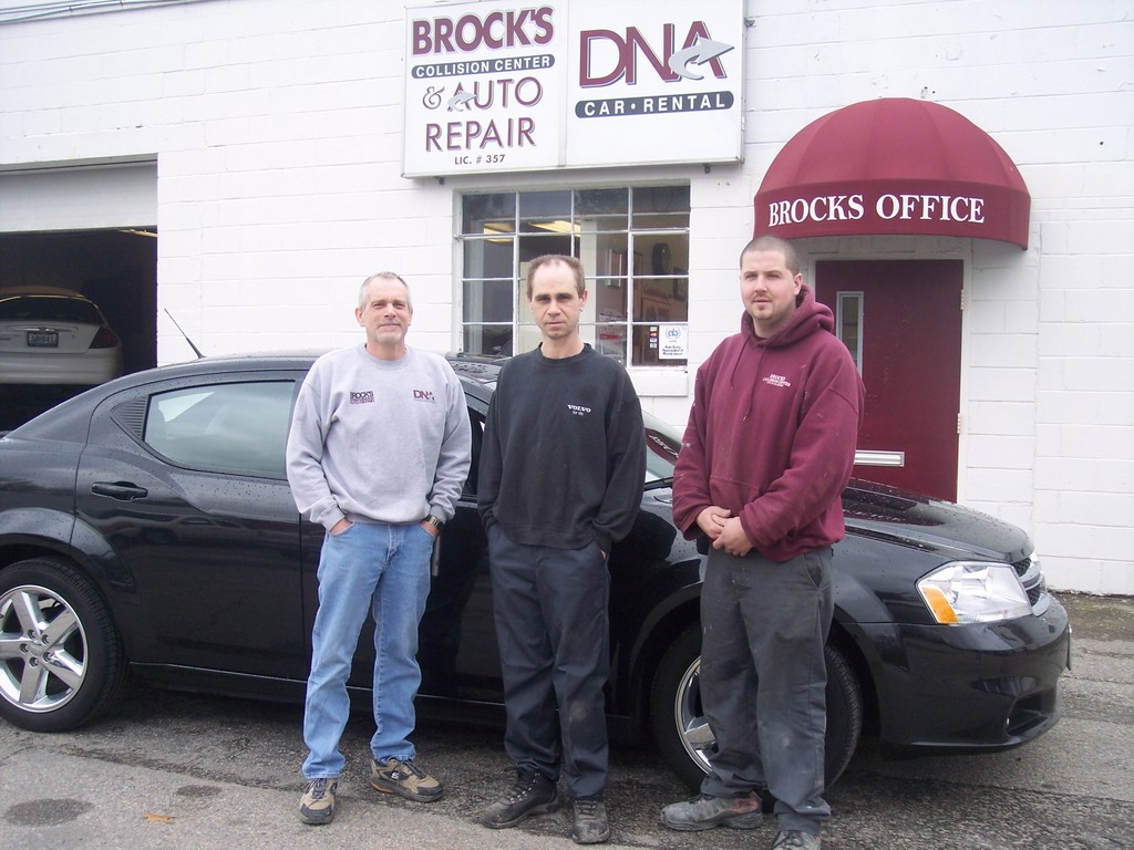 Technicians Paul Tetreault and Michael Thoin join Anthony Broccoli as they show off Bob's shiny 2011 Avenger.